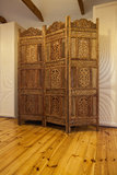 Cloudy home - wooden openwork screen. Cloudy home - wooden beautiful openwork screen in bedroom stock photo
