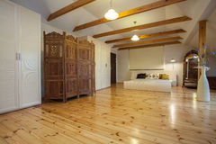 Cloudy home - wooden screen. Cloudy home - wooden original screen in huge spacious bedroom Royalty Free Stock Photo