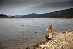Cloudy lake Stock Images