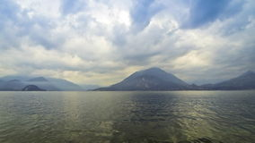 Cloudy landscape of Como Lake. Varenna town, Italy. (Time Lapse stock video footage