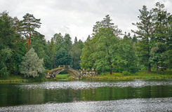 Cloudy landscape with medieval bridge in Gatchina Royalty Free Stock Photography