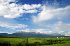 Cloudy landscape with mountains. Landscape with clouds and the High Tatras in the background Royalty Free Stock Photos
