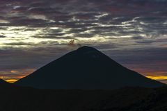 Cloudy landscape with silhoutte of volcano mountains on sunrise. Bali, Indonesia royalty free stock photo