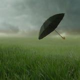 Cloudy landscape with umbrella Stock Photos