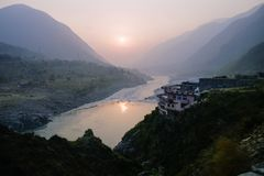 Cloudy landscape view of sunset over Indus river and layers of Karakoram mountain range, Pakistan. stock image