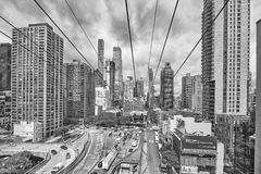 Cloudy Manhattan seen from aerial tramway going to Roosevelt Island. New York City, USA - May 26, 2017: Cloudy Manhattan seen from aerial tramway going to Royalty Free Stock Image
