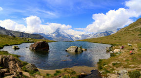 Cloudy Matterhorn and beautiful stellisee Royalty Free Stock Photos