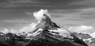 Cloudy Matterhorn. The Matterhorn (German), Monte Cervino (Italian) or Mont Cervin (French), is a mountain in the Pennine Alps on the border between Switzerland Stock Image