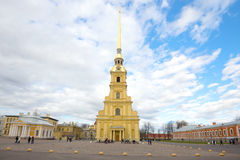 A cloudy May day in the Peter and Paul Fortress. View of the Peter and Paul Cathedral. Saint-Petersburg Royalty Free Stock Images