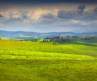 Cloudy morning on countryside in Tuscany Stock Photos
