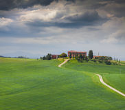 Cloudy morning on countryside in Tuscany Stock Image