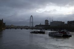Cloudy morning in London with London Eye and Thame River. London is really a foggy and cloudy city. Picture was taking at the beginning of April of 2017 royalty free stock photo
