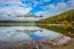 Cloudy morning in the Rocky Mountains. Pyramid Mountain beautifully reflected in Pyramid Lake. Cloudy morning in the Rocky Mountains, Jasper Park. The concept of Royalty Free Stock Image