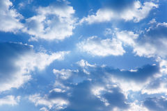 Cloudy morning sky. Blue morning sky and big fluffy clouds stock images
