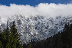Cloudy mountain. Piatra Craiului mountain in the spring with clouds on the peeks Stock Images