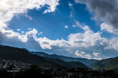 Cloudy mountain landscape. A traditional Bulgarian mountain town on a rainy day Royalty Free Stock Image