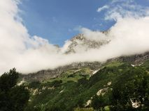 Cloudy mountain stock photography