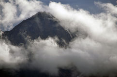 Cloudy Mountain Peaks. A rugged mountain among the clouds Royalty Free Stock Photo