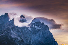 Cloudy mountain peaks at sunset Royalty Free Stock Photo