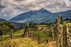 Cloudy Mountain. View of a Cloudy Mountain and a fence Royalty Free Stock Photo