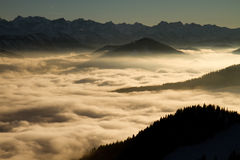 Cloudy mountains. Clouds in the evening sun Stock Photos
