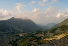 Cloudy mountains. Hiking in the Retezat Mountains in Transylvania Royalty Free Stock Photo