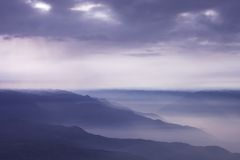 Cloudy mountains Stock Images