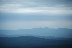 Cloudy mountains landscape Stock Photo
