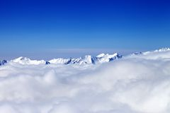 Cloudy mountains at nice winter day Royalty Free Stock Images