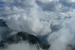 Cloudy mountains peaks Royalty Free Stock Photos