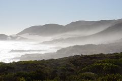 Cloudy Mountains in South Africa. With waves of the ocean Royalty Free Stock Photo