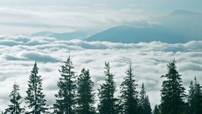 Cloudy mountains time-lapse. View above clouds in mountains, time-lapse stock video footage