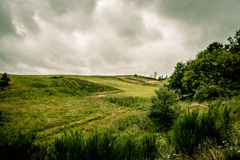 Cloudy nature. Green fields and cloudy weather Royalty Free Stock Photography