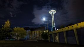 Cloudy Night in Seattle by the Space Needle. Time Lapse on a Cloudy Night in Seattle by the Space Needle with Moon Rising stock footage