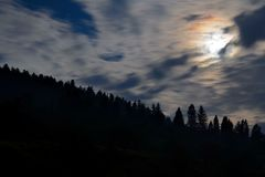 Cloudy night sky with the moon in the mountains Pieniny, Poland Stock Images