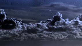 Cloudy night with stars. Cloudy night sky with stars stock photography