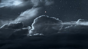 Cloudy night sky with stars Stock Image