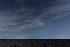 Cloudy Night sky with stars. Night background. Night sky. Royalty Free Stock Photography