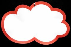 Cloudy Note. A single note pined on a black background Royalty Free Stock Photo
