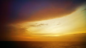 Cloudy ocean sunset stock video footage