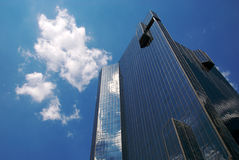 Cloudy Office. A corporate office with clouds reflecting off of its surface Royalty Free Stock Photos