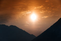 Cloudy orange mountain sunset royalty free stock photos