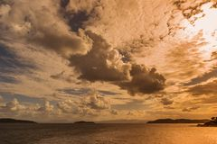 Cloudy orange sunset. Beautiful heavenly sunset with sunbursts, religion / faith / beliefs concept royalty free stock image