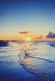 Cloudy orange sunset over sea water. Royalty Free Stock Image