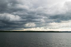 Cloudy Orava. Orava with heavy clouds and rain stock photo