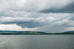Cloudy Orava. Orava with heavy clouds and rain stock photos