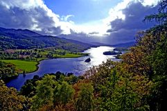 Cloudy over the loch. View and loch at Stock Photo