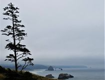 Distant view of Haystack Rock at Canon Beach, Oregon stock photos