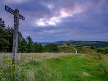 Cloudy overcast summer sunrise over the South Downs Way footpath from Beacon Hill and Harting Down in the South Downs National royalty free stock photos