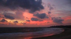 Cloudy, pink sunrise on Tynemouth Longsands beach royalty free stock image